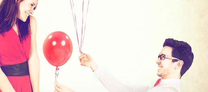 man giving woman a balloon